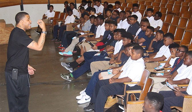 "Tommie Mabry, who was kicked out of Whitten Preparatory Middle School more than a decade ago, told young men there to let music like that of Lil Boosie be the ""passion of your ear, not your lifestyle."" Photo courtesy Jackson Public Schools"