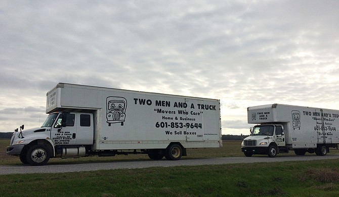 Two Men and a Truck started 30 years ago as an after-school business for two high-school boys, brothers Brig and Jon Sorber. Photo courtesy Facebook/Two Men and a Truck