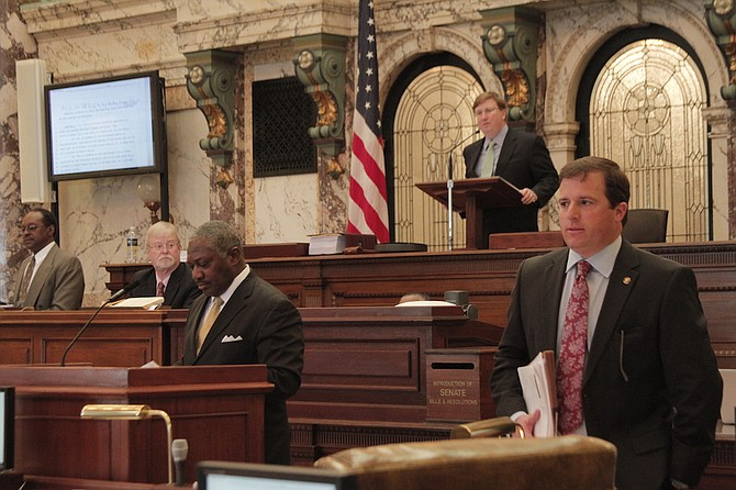"""Senator John Horhn (left) offered five amendments to the """"airport takeover"""" bill authored by Senator Josh Harkins (right) before it passed the Senate on March 3, 2016."""