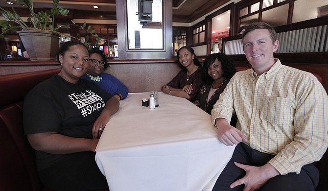 Carlyn Hicks (front left) founded JXN Foodies in 2015. She is pictured with Tiffany Paige (back left), Marlene Wright (back right), Marcia Keys (middle right) and Stephen Parks (front right).