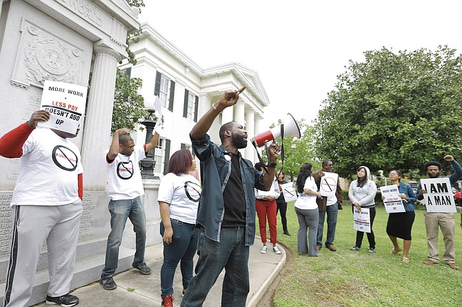 The Mississippi Alliance of State Workers, city workers and community organizers held a rally in front of City Hall today to protest the city-mandated furloughs implemented last October.
