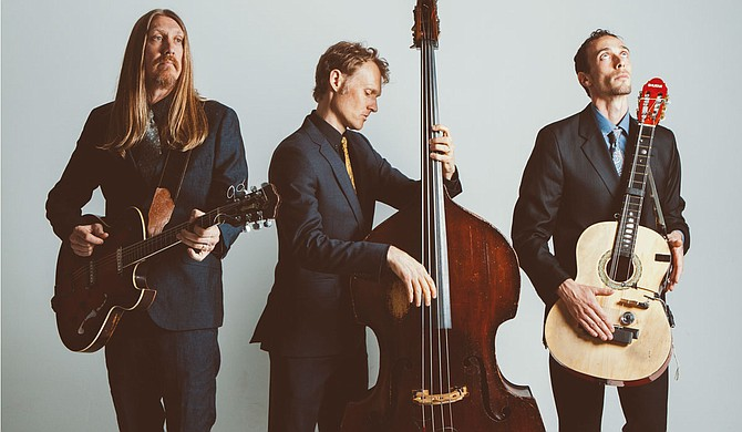 (Left to right) Oliver Wood, Chris Wood and Jano Rix of The Wood Brothers