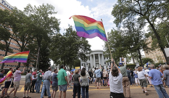 Hundreds of protesters marched from the Capitol to the governor's mansion on Sunday, calling on the state's leadership to repeal House Bill 1523.