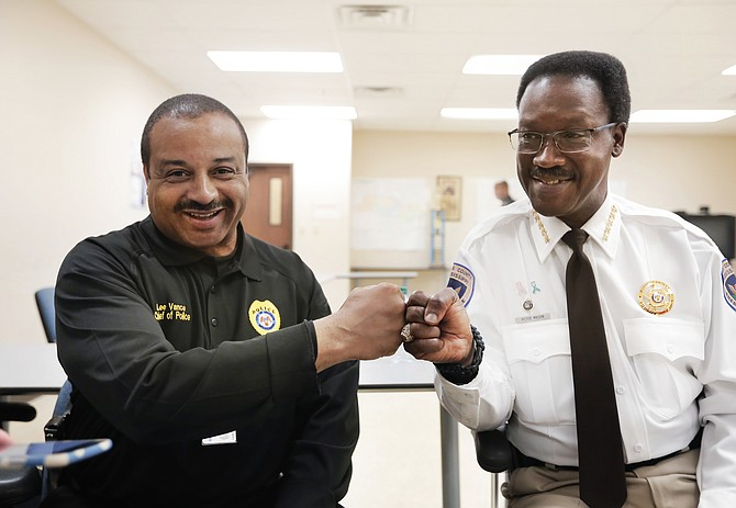 Jackson Police Chief Lee Vance (left) and Hinds County Sheriff Victor Mason fist-bump after the 2nd Precinct roll call as they talked on April 15 about Operation Side-by-Side that they were launching that night.