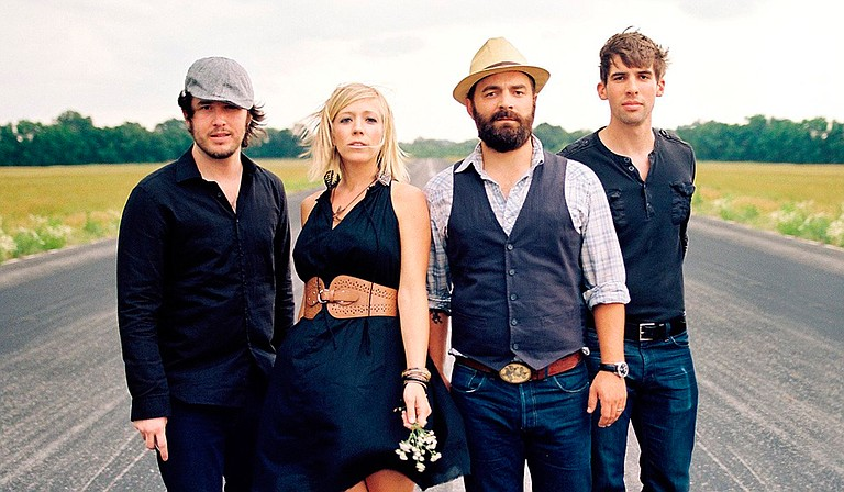 Nashville-based singer-songwriter Drew Holcomb (center right) and his band, the Neighbors (left: Rich Brinsfield; center left: Ellie Holcomb; right: Nathan Dugger), perform for the Stray at Home Art & Music Festival, Saturday, May 7, at Smith Park. Photo courtesy The Neighbors