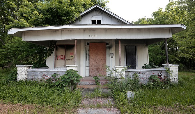 The Jackson Police Department has houses, such as this one in west Jackson, slated for demolition, as the house numbers spray-painted in red indicates.