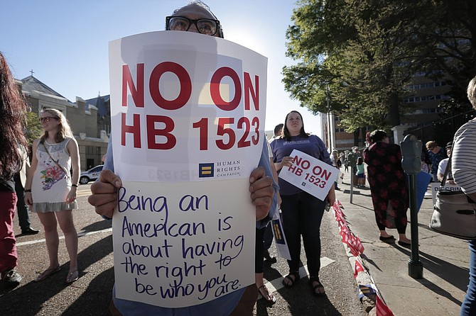 Protesters rallied against House Bill 1523 in April, which will become law on July 1 unless U.S. District Judge Carlton Reeves blocks it this week.