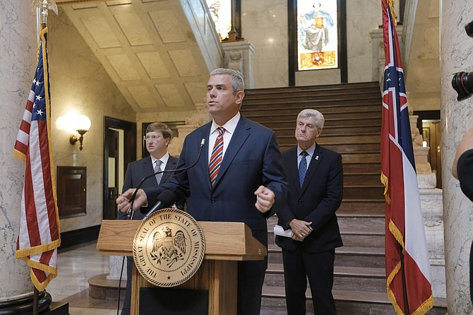 House Speaker Philip Gunn (center), Lt. Gov. Tate Reeves (left) and Gov. Phil Bryant (right) announced last week that working groups of legislators will look at individual state agency budgets as well as the state's tax code.