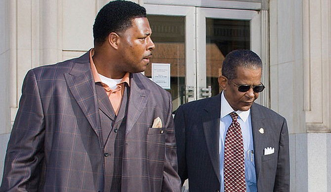Rev. Robert Earl Henderson Jr. (left) was a long-time supporter of Mayor Frank Melton (right). Here he accompanies the then-mayor from his federal trial in 2009 for destroying a duplex in the Virden Addition with sledgehammers. Photo courtesy Kenya Hudson/File photo