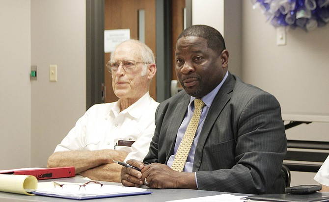 Johnnie McDaniels, the executive director of the Henley-Young Juvenile Justice Center, explained that a new agreement puts Youth Court Judge William Skinner, the county and the facility administrators on the same page about policies such as the maximum population and length of stay for children in the facility. George Porter, a retired councilor, is on the left.