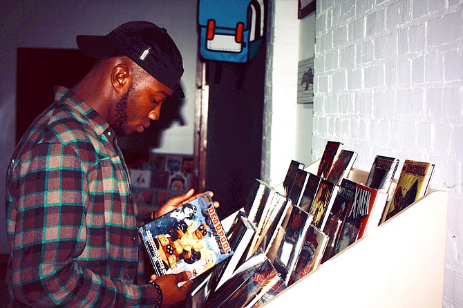 Jackson hip-hop artist devMaccc is an official brand manager for record, comic and collectibles store Offbeat in midtown. Photo courtesy Jamarcus Easterling