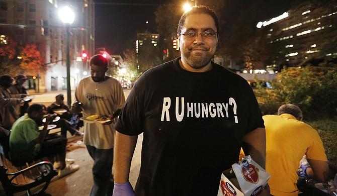 Bilal Qizilbash heads R U Hungry?, a local group that gathers food and items such as blankets to give to homeless individuals in Smith Park in downtown Jackson on Fridays.