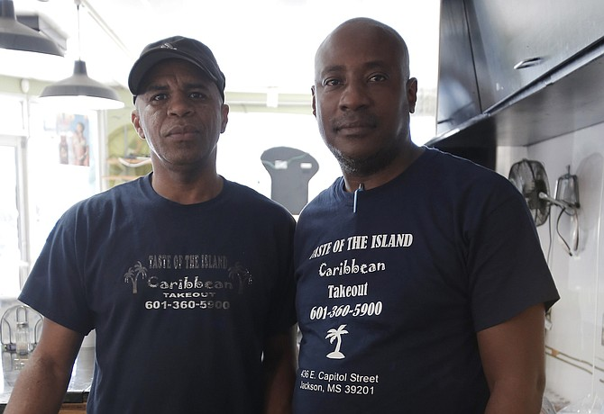 Richard Higgins (right) opened Taste of the Island in June 2009. He is pictured with the restaurant manager, Clayton Brown (left).
