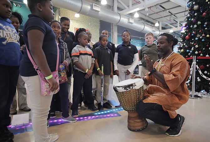 Jerry Jenkins plays an African drum for fourth-grade students at McLaurin Elementary School in Natchez. The Mississippi Alliance of Arts Education funded the drum for the students.