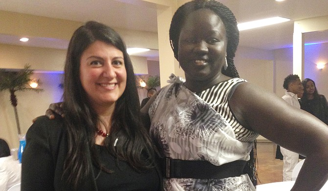Nina Ghaffari (left) and Akech Garkouth (right) pose at the Emancipation Celebration on Wednesday, Dec. 7; both of them work for the Catholic Charities Unaccompanied Refugee Minor Program in Jackson, and Garkouth is a former refugee minor who went through the program.