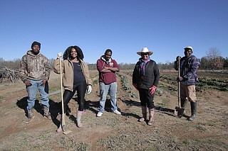 (Left to right) Zachary Williams, Chrisshawn Alexander, Curtis Williams, Cindy Ayers-Elliott and Daniel Murray are some of the farmers at Foot Print Farms.
