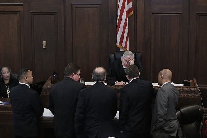 Judge Larry Roberts declared a mistrial in the case against of Hinds County DA Robert Shuler Smith (man on left), but many questions about the bribery schemes remain.