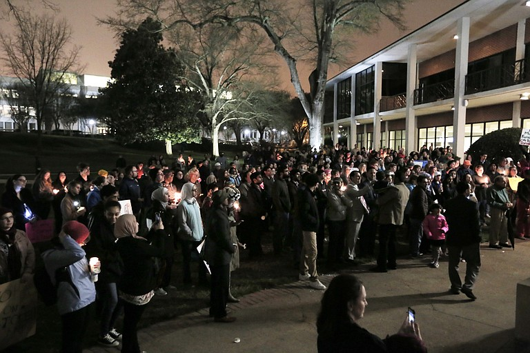 Over a hundred Mississippians gathered at Millsaps College for a peaceful vigil in support of Muslims, immigrants and refugees potentially affected by executive orders President Donald Trump signed last week.