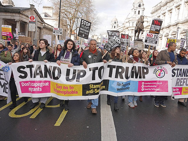Protests erupted worldwide after President Trump banned entry to immigrants from a select number of Muslim-majority nations. Shown are protesters in London.