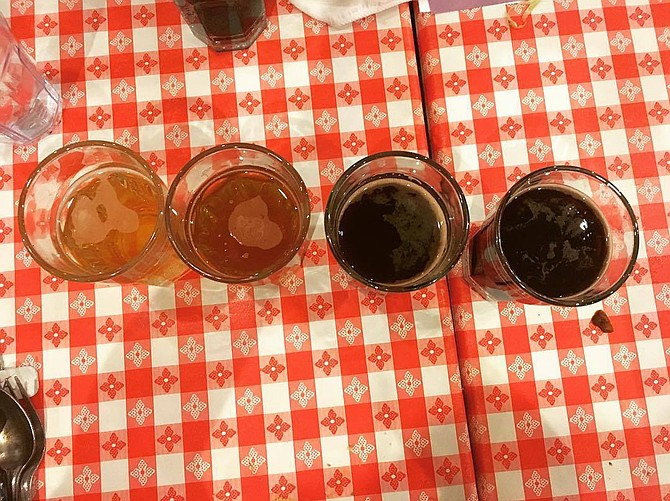 At a Wiseacre Brewing Co. beer dinner on Jan. 30, guests tried Wiseacre beers such as Ananda IPA (far left), Adjective Animal double IPA (center left), Bird Upon a Hippo Belgian stout (center right) and Gotta Get Up to Get Down coffee milk stout (far right).