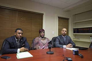 Yvette Mason-Sherman (middle) filed a civil lawsuit against Wayne Parish, the man arrested for killing her son last fall. Charles Tucker (left) and Carlos Moore (right) represent her.