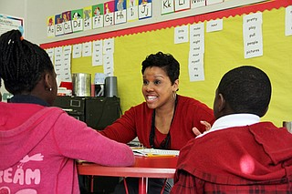 In this 2014 photo, literacy coach Kristen Wells works with students at Emmalee Isable Elementary in west Jackson. Literacy coaches are used statewide to help teachers teach literacy and boost reading scores. Photo courtesy Jackie Mader/The Hechinger Report