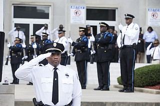 The memorial service program ended with seven officers shooting their ceremonial rifles towards the sky in a 21-gun salute in honor of the fallen officers.