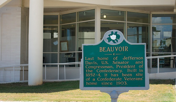 A sign designating the last home of Jefferson Davis sits outside Beauvoir in Biloxi, Miss.
