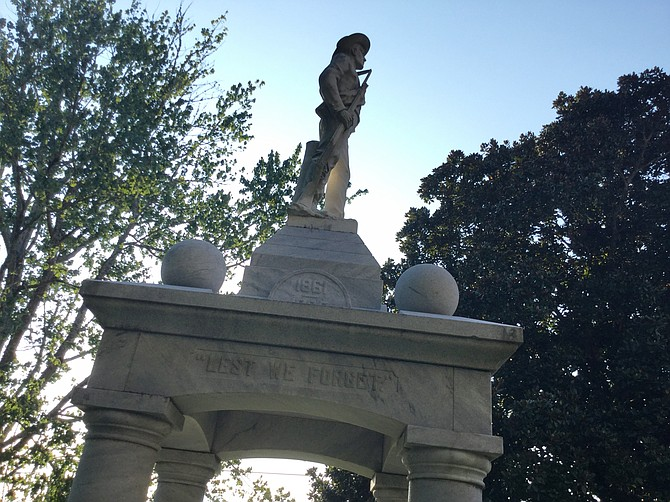 "In Ellisville, in the heart of the ""Free State of Jones,"" the memorial is ornate and direct, ""less we forget"" the Confederate cause. ""The principles for which they fought live eternally,"" one side states."