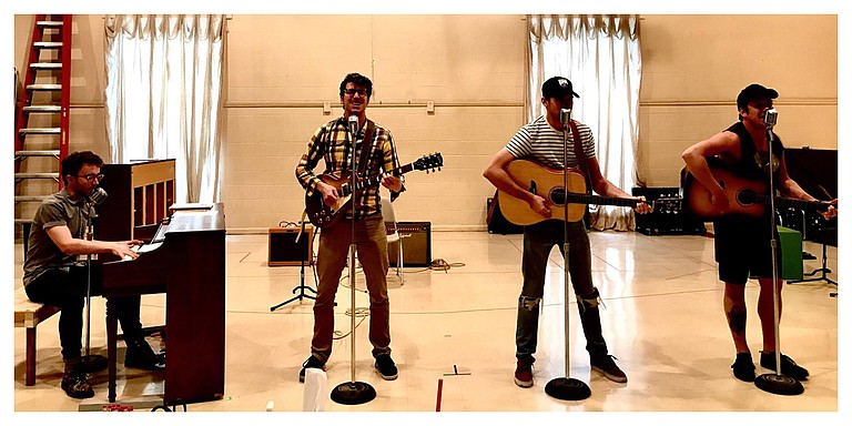 "(Left to right) Ian Fairlee, Austin Hohnke, Austin Thomas and Austin Wayne Price during rehearsal. The four star in ""Million Dollar Quartet,"" which runs May 30-June 11 at New Stage Theatre. Photo courtesy Melissa Tlilman"