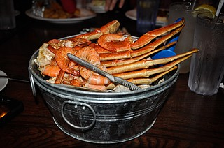 A crab and shrimp boil is an easy way to feed a large group of people without overspending. Photo courtesy Flickr/Chrisgent