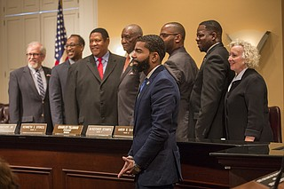 Mayor Chokwe Lumumba stands with the city council members after Charles Tillman and Melvin Priester, Jr. are named president and vice president.
