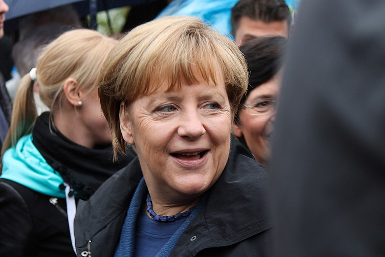 """German Chancellor Angela Merkel said the U.S. position on the Paris climate agreement was """"regrettable"""" but that the summit had achieved """"good results in some areas,"""" and cited a hard-won agreement on trade that included Trump and the United States but did not erase the differences over the issue. She said the talks had been at times """"difficult."""" Photo courtesy Flickr/Philipp"""