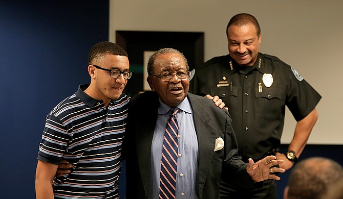 Former Ward 4 Councilman Frank Bluntson acknowledged his grandson Connor Bluntson during his speech after receiving the lifetime achievement award from the Jackson Police Department.