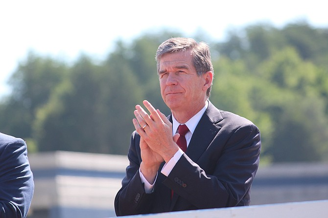 The compromise between Republican legislative leaders and Democrats led by Gov. Roy Cooper (pictured) eliminated a provision that required transgender people to use restrooms in many public buildings corresponding to the sex on their birth certificates. Photo courtesy Flickr/NCDOTcommunications