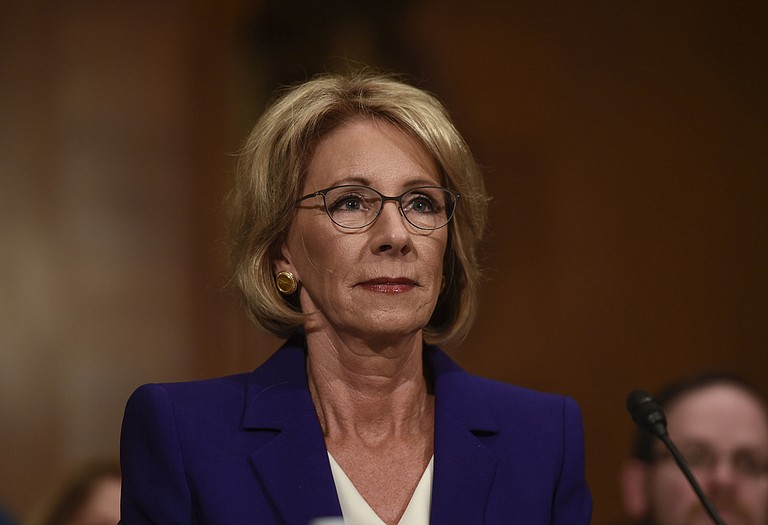 """Education Secretary Betsy DeVos on Wednesday distanced herself from her comment earlier this year about the nation's historically black colleges and universities being pioneers of school choice, saying that in the past """"there were no choices"""" for African-Americans in higher education. Photo courtesy AP/Riccardo Savi"""