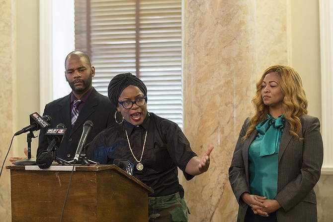 "Actress and activist Aunjanue Ellis (center), with Ward 3 Councilman De'Keither Stamps (left) and Dr. Edelia Carthan (right), said at the Mississippi Capitol that it is ""a civil right to not feel tormented and terrorized by symbols."" Therefore, she insists, the Mississippi flag must change and with white support."