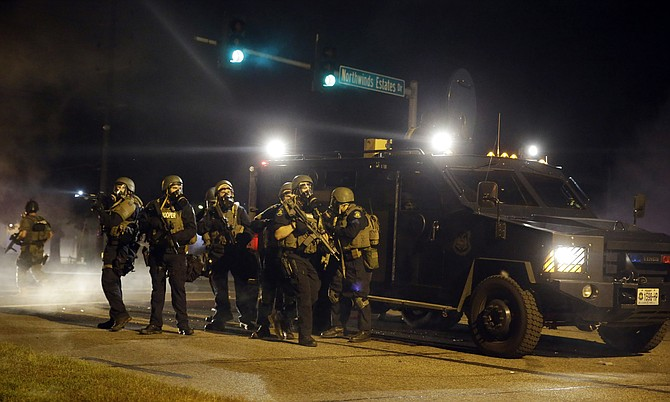 """Three years ago this month, the nation witnessed a highly militarized, violent crackdown by police on protesters in Ferguson. Today's executive order erases the sensible limits placed by the Obama administration after Ferguson on the kinds of military equipment flowing from the federal government to local police and into our neighborhoods."" Photo courtesy AP/Jeff Roberson"
