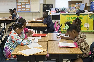 Children read during Operation Shoestring's afterschool programming, which the organization calls Project Rise.