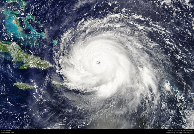 Hurricane rolled past the Dominican Republic and Haiti and battered the Turks and Caicos Islands early Friday with waves as high as 20 feet. Photo courtesy Flickr/Antti Lipponen