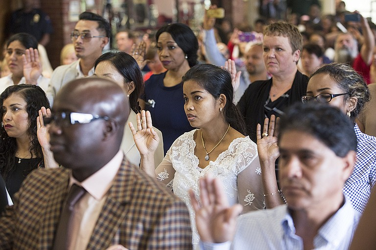 Thirty-five new American citizens from 23 countries took the oath of citizenship in their naturalization ceremony hosted at Northwest Jackson IB Middle School Monday, Sept. 18.