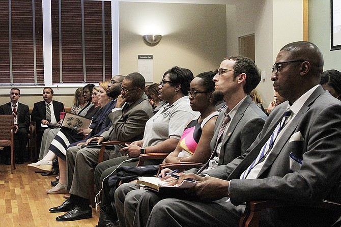 "Jackson Public Schools Board of Trustee members and supporters look on as the Mississippi Board of Education Chairwoman Paula Vanderford announces the decision to declare JPS in an ""extreme emergency"" situation on Sept. 14."