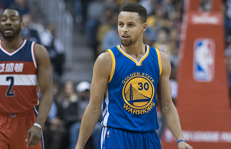 """Stephen Curry (pictured) had said he did not want to go anyway, but the Warriors had not made a collective decision before Saturday—and had planned to discuss it in the morning before the president's tweet, to which coach Steve Kerr said : """"Not surprised. He was going to break up with us before we could break up with him."""" Photo courtesy Flickr/Keith Allison"""