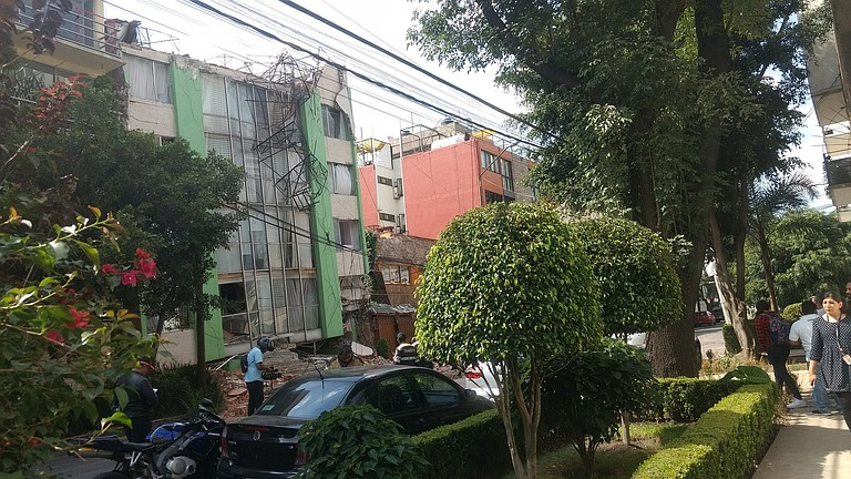 At least 38 buildings, including apartments and office buildings, collapsed during the earthquake. Photo courtesy Flickr/b de baca