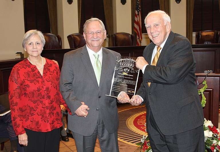 Former Mississippi Supreme Court Justice Jess Dickinson (center), with his wife Janet (left) and Justice Jim Kitchens (right), became the commissioner of the Mississippi Department of Child Protection Services last week and faces a slew of backlogged cases. Photo courtesy Administrative Office of the Courts