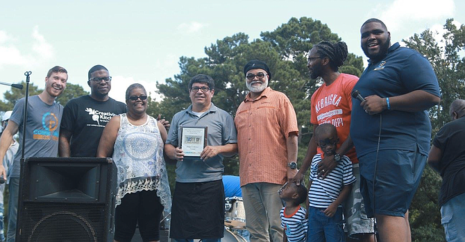 Local restaurants and chefs submitted dishes for the event's West Jackson Food Competition, and a panel of judges and attendees voted separately on first-place and second-place winners. (left to right) Alan Grove, Nick Wallace, Lee Harper, Clemente Ochoa, Pastor Calvin Waddy, Micah Briggs and Pastor John P. Perkins Photo courtesy Alan Grove