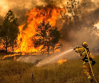 More than a dozen wildfires whipped by powerful winds swept through California wine country Monday, destroying at least 1,500 homes and businesses and sending an estimated 20,000 people on a headlong flight to safety through smoke and flames. Photo courtesy Bureau of Land Management California