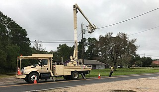 Nate knocked out power to more than 100,000 residents in Mississippi, Alabama, Louisiana and Florida, but crews worked on repairs and it appeared most of the outages had been fixed by Monday morning. Photo courtesy Singing River Electric Power Association