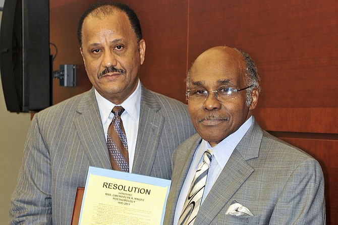 Former Trustee Bob Owens (left) presents a resolution to D.E. Magee, Jr. (right) at the 2012 Black History Month recognition ceremony in honor of the late Mrs. Magee. Photo courtesy Mississippi Institutions of Higher Learning