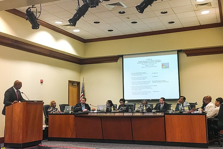 Six members of the revamped Jackson school board took their oath on Tuesday, Nov. 29, before getting to work in their first meeting.